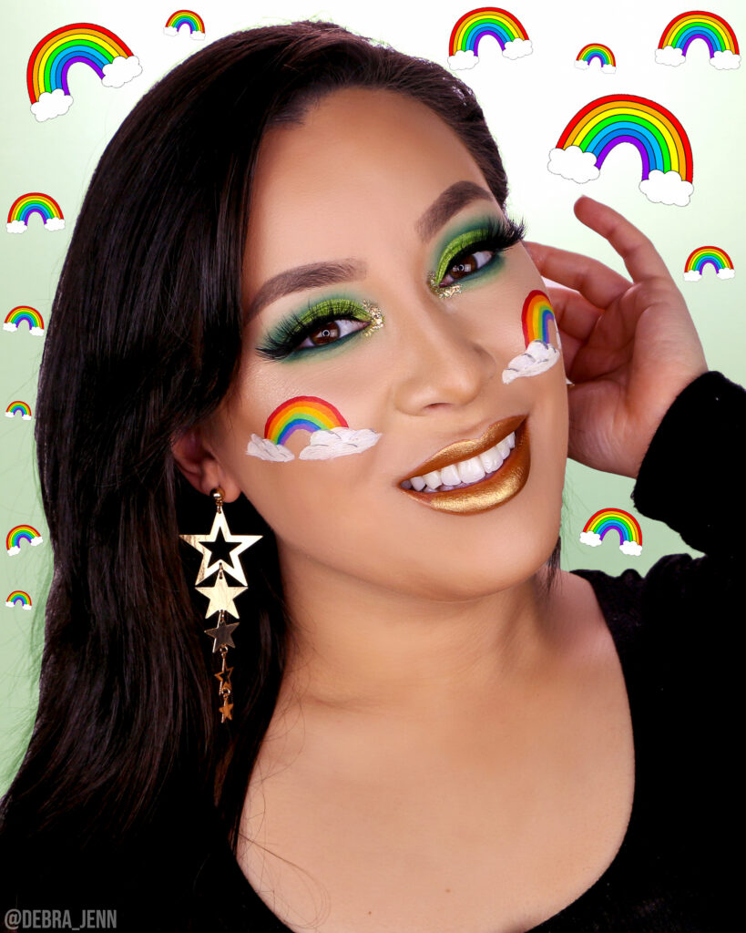 St Patricks Day Makeup with green eyeshadow and rainbow on cheeks
