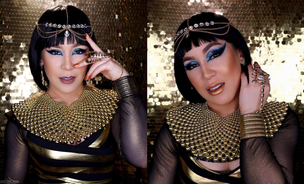 cleopatra makeup with blue eyeshadow and big gold necklace, scorpion bracelet, and gold head piece