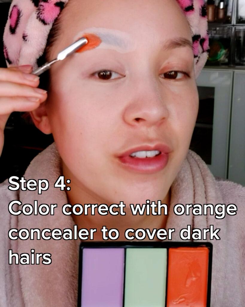 use orange concealer to color correct eyebrows
