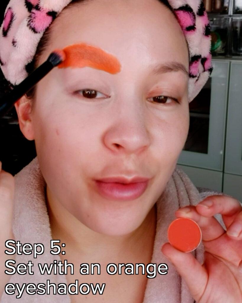 use orange eyeshadow to set brows