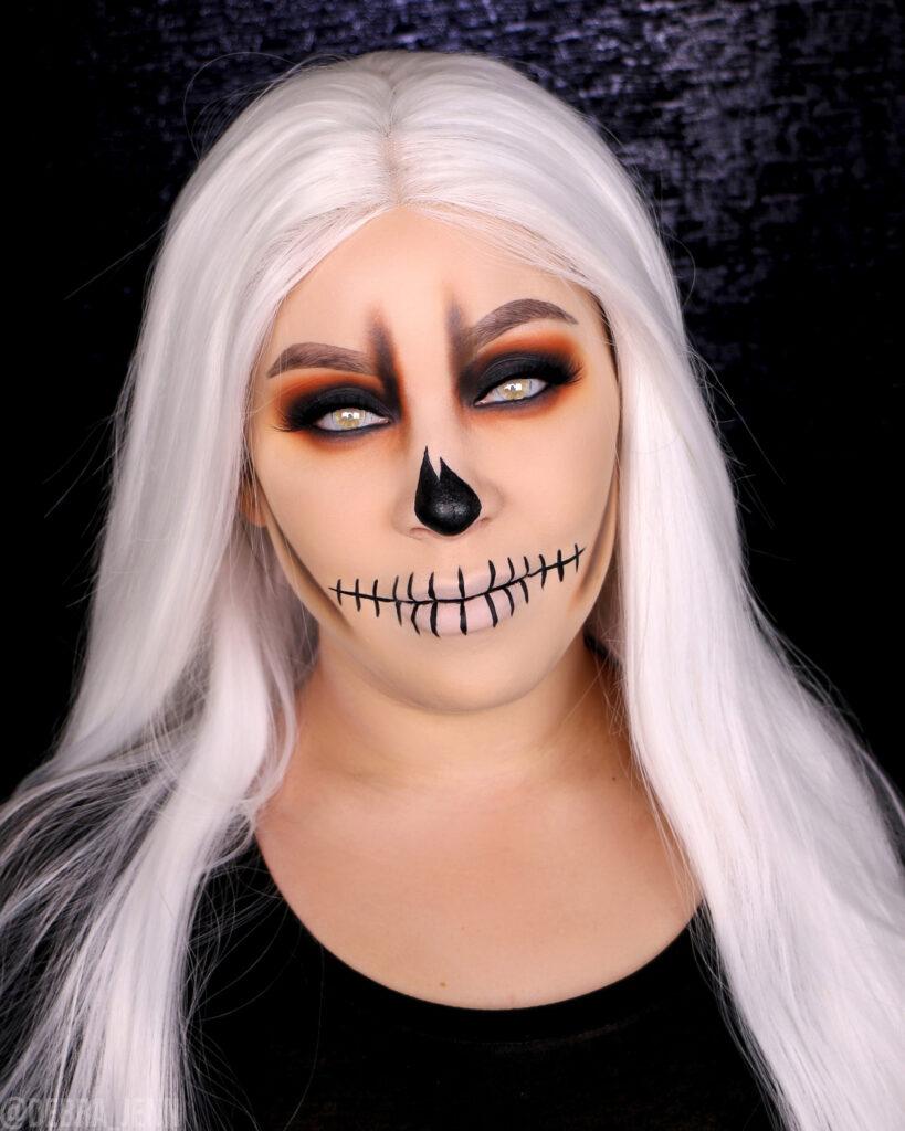 White skull makeup for halloween with smokey eyes, skeleton teeth and white hair